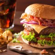 Bacon cheese burger with beef patty tomato onion cola — Stock Photo #80461162