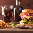 Bacon cheese burger with beef patty tomato onion cola — Stock Photo #80461180