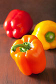 Healthy colorful bell peppers on rustic background — Stock Photo