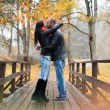 Happy middle-aged couple kissing outdoors on beautiful autumn day — Stock Photo #51891379
