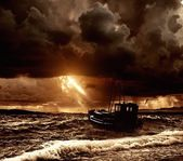 Fishing boat in a stormy sea — Stock Photo