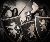 Three medieval knights in a smoke  — Stock Photo
