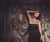 Tattooed beautiful woman in old spooky interior — Stock Photo