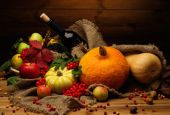 Thanksgiving day autumnal still life with bottle of wine  — Stock Photo