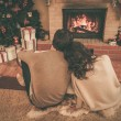 Couple near fireplace in Christmas decorated house interior — Stock Photo #54270409