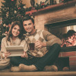 Couple near fireplace in Christmas decorated house interior  — Stock Photo #54270477