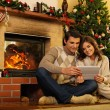 Couple near fireplace in Christmas decorated house interior  — Stock Photo #54270483