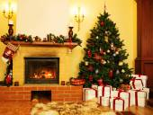 Christmas decorated house interior with fireplace — Stock Photo