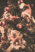 Christmas still life with teddy bears decorating tree  — Stock Photo