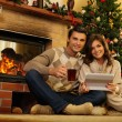 Couple near fireplace in Christmas decorated house interior  — Stock Photo #54788171