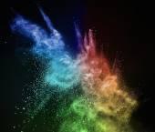Colourful powder exploding isolated on black — Stock Photo