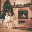 Happy mother with her son in Christmas decorated house interior — Stockfoto #55349925