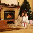 Happy mother with her son in Christmas decorated house interior — Stockfoto #55349927