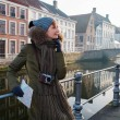 Woman tourist along canal in Bruges, Belgium — Stock Photo #55350203