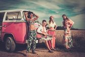 Multi-ethnic hippie friends with guitar on a road trip — Stockfoto