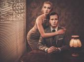 Well-dressed retro couple behind table — Foto de Stock
