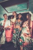 Multi-ethnic hippie friends with guitar on a road trip — Foto de Stock
