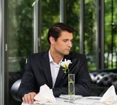 Handsome man in jacket waiting someone in restaurant  — Foto de Stock