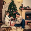Happy family decorating Christmas tree — Stock Photo #57138695