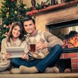 Couple near fireplace in Christmas decorated house interior  — Stock Photo #57138769