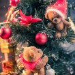 Christmas still life with teddy bears decorating tree — Stock Photo #57139163