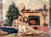 Family near fireplace in Christmas decorated house interior — Stock Photo