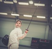 Little girl fencer with epee and mask — Foto de Stock