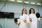 Young woman fencer and her trainer  — Stock Photo