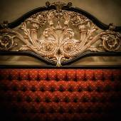 Back of expensive bed with golden ornament — Stockfoto