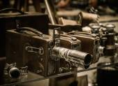 Vintage cameras and lenses on a shelf  — Stockfoto