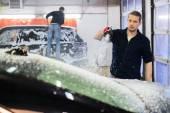 Man worker washing luxury car on a car wash  — Stock Photo