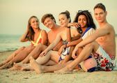 Group of multi ethnic friends on a beach — Stock Photo