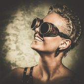 Attractive steam punk girl wearing googles — Stock Photo