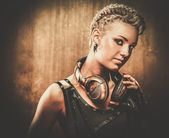 Attractive steampunk girl with headphones — Stock Photo