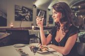 Beautiful young lady alone in restaurant  — Foto de Stock
