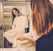Woman choosing clothes in a showroom — Stock Photo