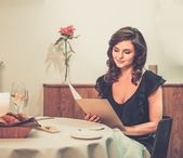 Young lady choosing food in restaurant — Stock Photo