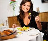 Young lady alone in restaurant — Stock Photo