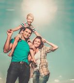Family with their child outdoors — Stock Photo