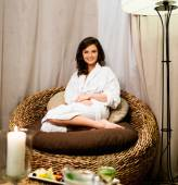 Woman relaxing in a bathrobe in spa salon — Stock Photo
