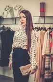 Young woman in a fashion showroom — Stock Photo