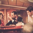 People behind poker table in a casino — Stock Photo #60820307