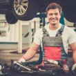 Mechanic with tools in a car workshop — Stock Photo #61550883