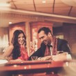 Couple behind poker table — Stock Photo #61550983