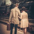 Vintage style couple on train station platform — Stock Photo #61551047