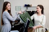 Woman customer paying in fashion showroom — Stock Photo