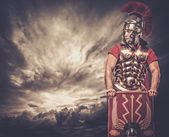 Legionary soldier and stormy sky — Stock Photo