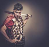Legionary soldier with sword — Stock Photo
