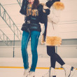 Two girls on ice-skating rink — Stock Photo #63291831