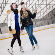 Two girls on ice-skating rink — Stock Photo #63291837
